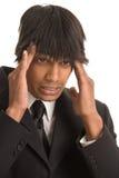 Homme d'affaires avec le mal de tête images libres de droits