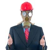 Homme d'affaires avec le masque et le casque de gaz Photographie stock
