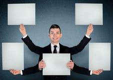 Homme d'affaires avec le panneau photos stock