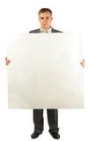 Homme d'affaires avec le panneau en plastique de mousse pour le texte Image stock