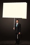 Homme d'affaires avec le papier de post-it Photographie stock libre de droits