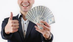 Homme d'affaires avec le paquet d'argent dans le studio sur un fond blanc Photo libre de droits