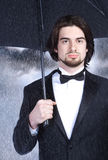 Homme d'affaires avec le parapluie Photo stock