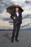 Homme d'affaires avec le parapluie Photo libre de droits