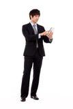 Homme d'affaires avec le PC de tablette Photographie stock libre de droits