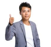 Homme d'affaires avec le pouce vers le haut Photographie stock libre de droits