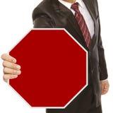Homme d'affaires avec le signe blanc d'arrêt Image stock