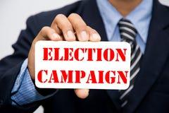 Homme d'affaires avec le signe de campagne électorale Image libre de droits