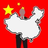 Homme d'affaires avec le signe de la Chine Image stock