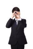 Homme d'affaires avec le télescope regardant en avant Photo stock