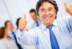 Homme d'affaires avec le thumbs-up Image stock