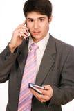 Homme d'affaires avec le téléphone et le journal intime Photo stock