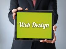 Homme d'affaires avec le web design sur un comprimé Photos libres de droits