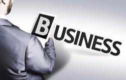 Homme d'affaires avec les affaires des textes dans une image de concept photo stock