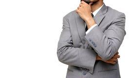 Homme d'affaires avec les bras pliés et la pensée Photo stock