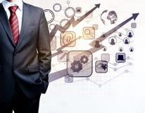 Homme d'affaires avec les graphiques de gestion numériques Photographie stock libre de droits