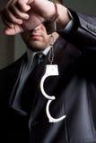 Homme d'affaires avec les menottes déverrouillées Image libre de droits