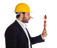 Homme d'affaires avec Pinocchio photographie stock