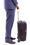 Homme d'affaires avec sa valise de chariot Image libre de droits