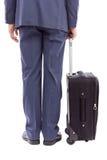 Homme d'affaires avec sa valise de chariot Photographie stock libre de droits