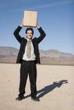 Homme d'affaires avec un cadre Image libre de droits