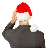 Homme d'affaires avec un chapeau de Santa, budget de la crise de Santa Image stock