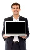 Homme d'affaires avec un ordinateur portable Photos stock