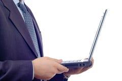 Homme d'affaires avec un ordinateur portatif Image libre de droits
