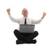 Homme d'affaires avec un ordinateur portatif Photographie stock