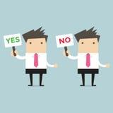 Homme d'affaires avec un signe oui et non Image stock