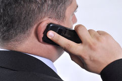 Homme d'affaires avec un téléphone portable Image libre de droits
