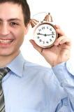 Homme d'affaires avec une horloge d'alarme dans une main. photos stock