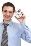Homme d'affaires avec une horloge d'alarme dans une main. photo stock