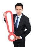 Homme d'affaires avec une marque d'exclamation de signe Photo stock
