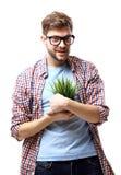 Homme d'affaires avec une plante verte d'isolement sur le fond blanc Image libre de droits
