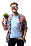 Homme d'affaires avec une plante verte d'isolement sur le fond blanc Photographie stock libre de droits