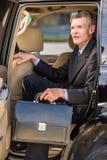 Homme d'affaires avec une serviette Photos stock