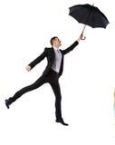 Homme d'affaires ayant l'amusement avec le parapluie Images libres de droits