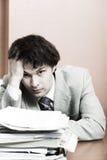 Homme d'affaires ayant le mal de tête photo stock