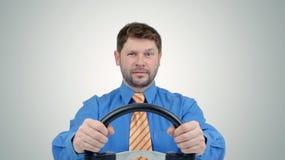 Homme d'affaires barbu avec un volant Photo stock