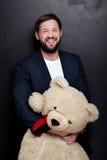 Homme d'affaires bel avec l'ours de nounours Image libre de droits