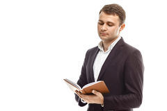 Homme d'affaires bel avec le journal intime Photos stock
