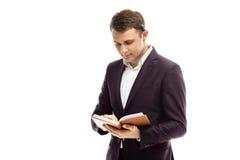 Homme d'affaires bel avec le journal intime Image libre de droits
