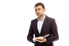 Homme d'affaires bel avec le journal intime Photo stock