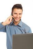 Homme d'affaires bel avec le téléphone et le cahier Images stock