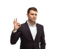 Homme d'affaires bel montrant le geste correct Images libres de droits