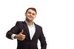 Homme d'affaires bel montrant le pouce  Photos libres de droits