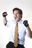 Homme d'affaires brut prêt à poinçonner Photo libre de droits