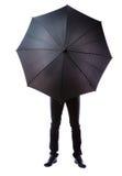 Homme d'affaires caché dans le parapluie photo libre de droits