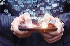 Homme d'affaires causant à un téléphone portable Images stock
